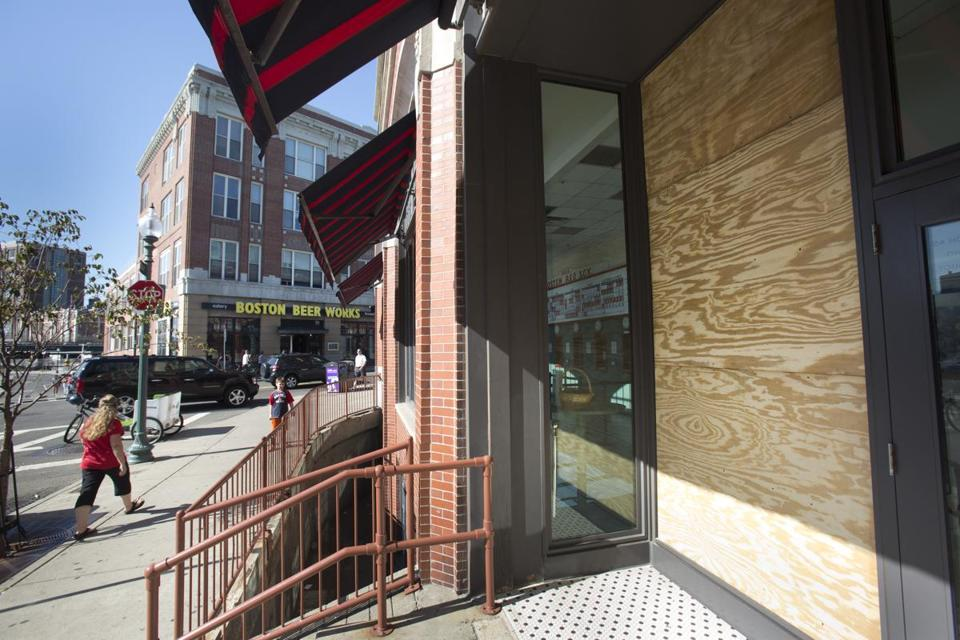 A window near the door of the main ticket office on Yawkey Way was damaged and boarded up until it can be replaced.