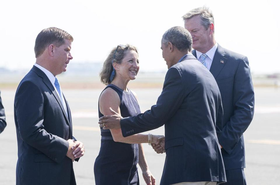 Arriving in Boston, the president was met by Mayor Martin J. Walsh (left), and Governor Charlie Baker (right) and his wife, Lauren.