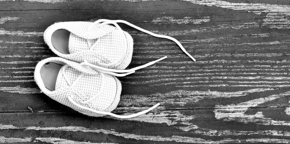 booties for baby on the old wood background; Shutterstock ID 273627851; PO: crib stuff