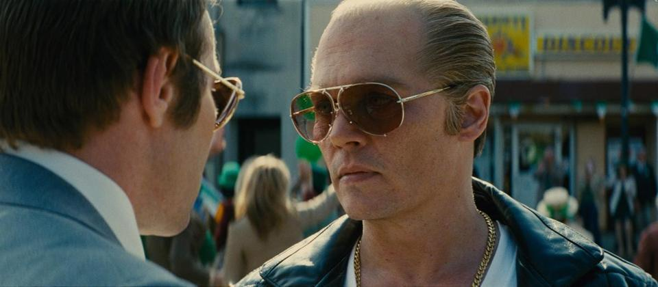 Caption: (L-r) JOEL EDGERTON as FBI Agent John Connolly and JOHNNY DEPP as Whitey Bulger in the 2015 film BLACK MASS, directed by Scott Cooper, a presentation of Warner Bros. Pictures in association with Cross Creek Pictures and RatPac-Dune Entertainment, released by Warner Bros. Pictures. 14blackmass