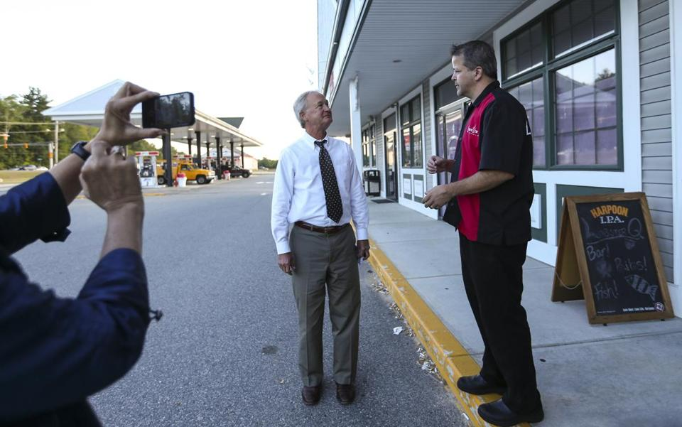 Chafee talked with Lobster Q restaurant owner Sean Hopkins during a break on a road trip in Hampstead, N.H.