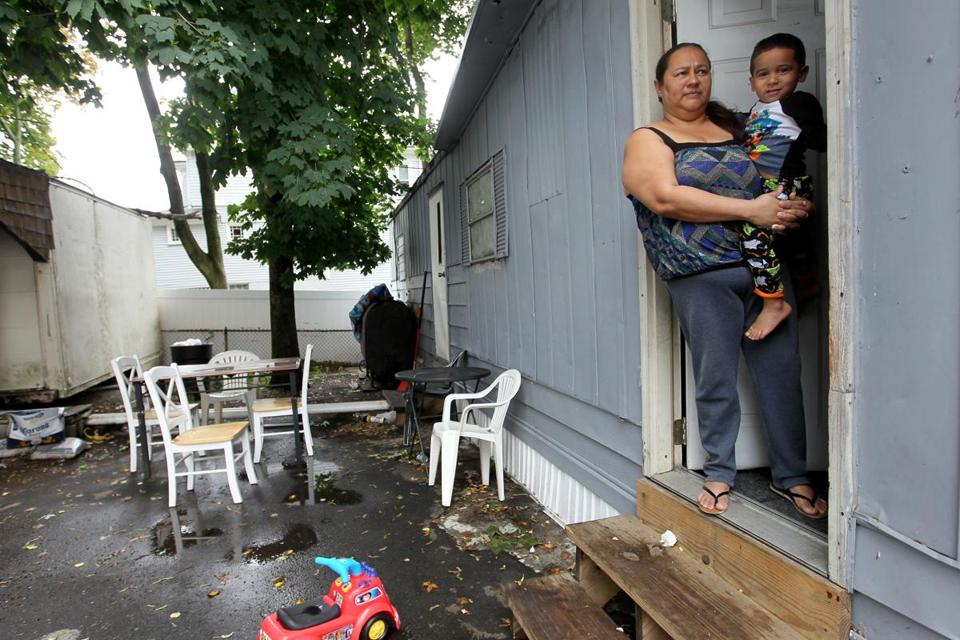 Marisela Ayala, holding grandson Liam, said she and her family have been renting a unit in Lee's Trailer Park, within a few miles of Suffolk Downs, for the last three months.
