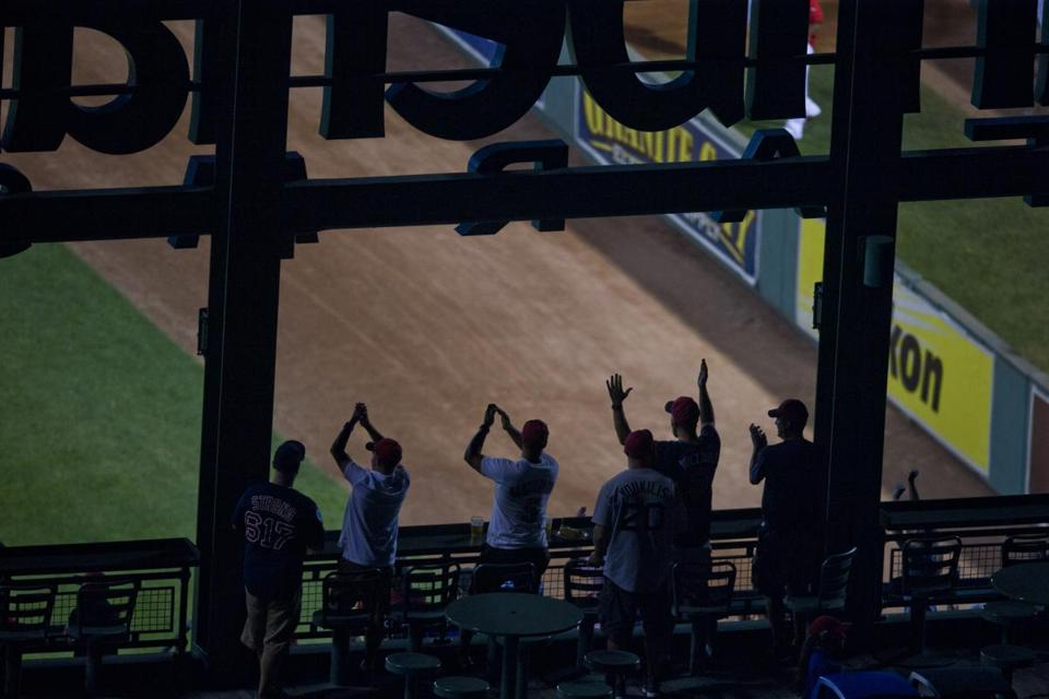 Fans of cheered a Travis Shaw home run around the Pesky pole.