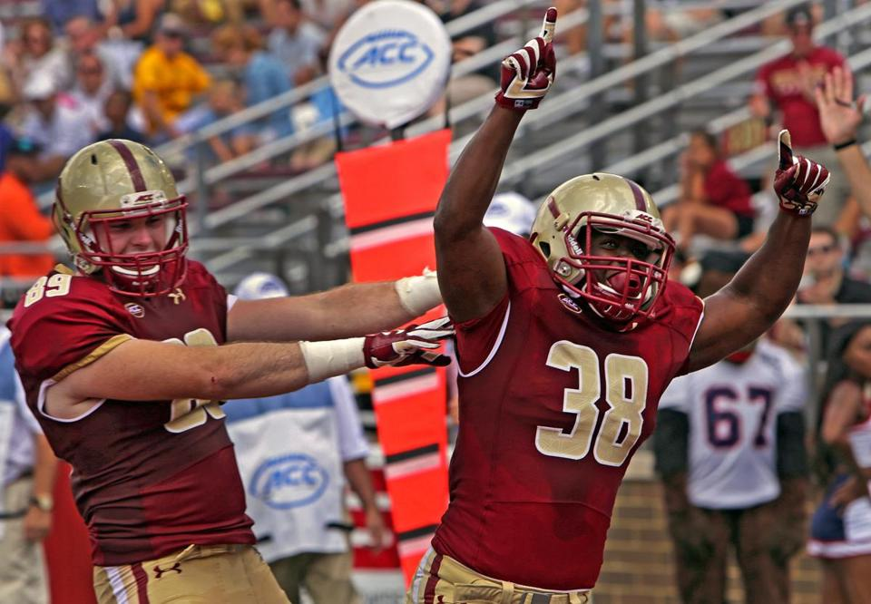 BC fullback Richard Wilson (38) celebrated his first-half touchdown with tight end Tommy Sweeney.