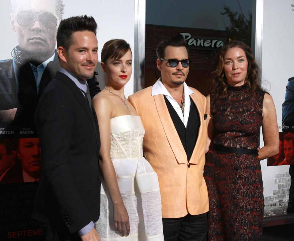 "From left: Director Scott Cooper, Dakota Johnson, Johnny Depp, and Julianne Nicholson attended the premiere of ""Black Mass"" at the Coolidge Corner Theatre in Brookline."