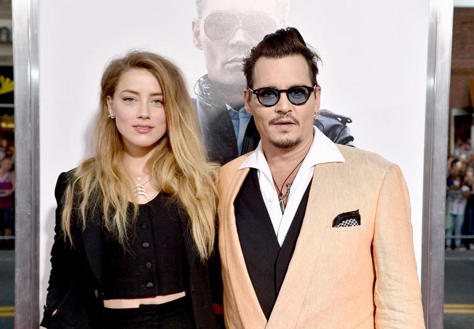 "Actors Amber Heard (left) and Johnny Depp attended the ""Black Mass"" screening at the Coolidge Corner Theatre in Brookline on Sept. 15."
