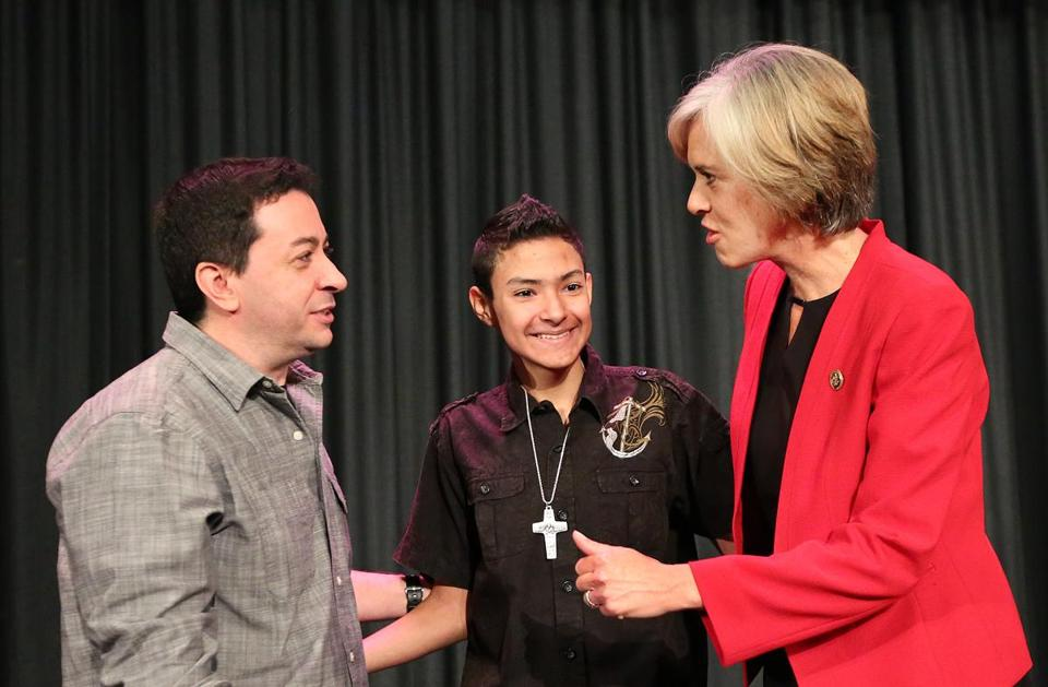 Dylan Lopez was flanked by his father Sebastian Lopez and Representative Katherine Clark.