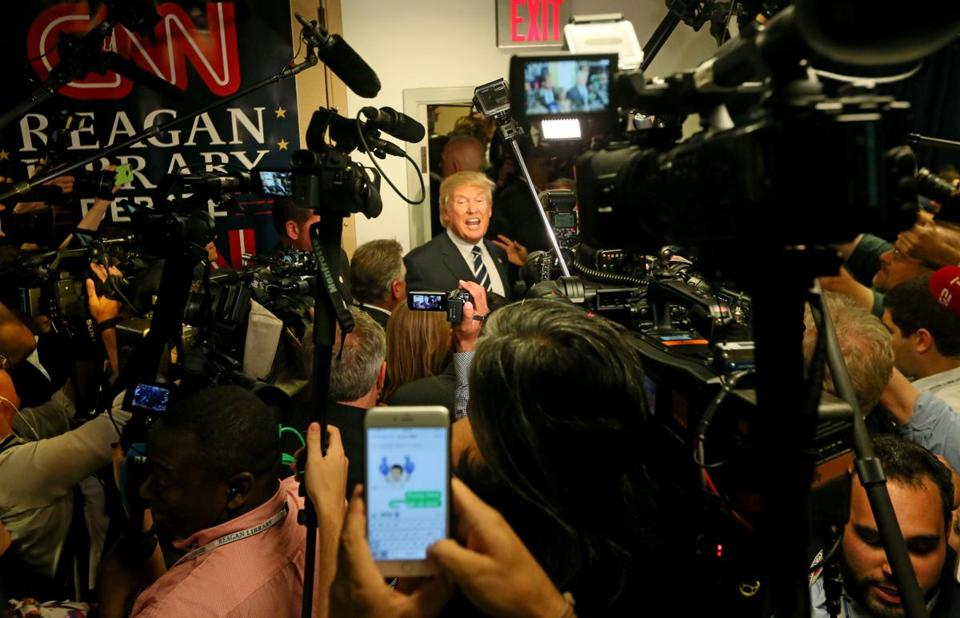 SIMI VALLEY, CA - SEPTEMBER 16: Republican presidential candidate Donald Trump speaks with reporters after the presidential debate at the Reagan Library on September 16, 2015 in Simi Valley, California. Fifteen Republican presidential candidates are participating in the second of presidential debates(Photo by Sandy Huffaker/Getty Images)