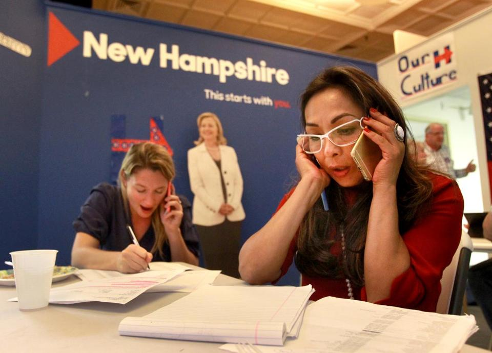 Letizia Ortiz (front) and Katie Gladstone handled phones at Hillary Clinton's headquarters in Manchester, N.H.