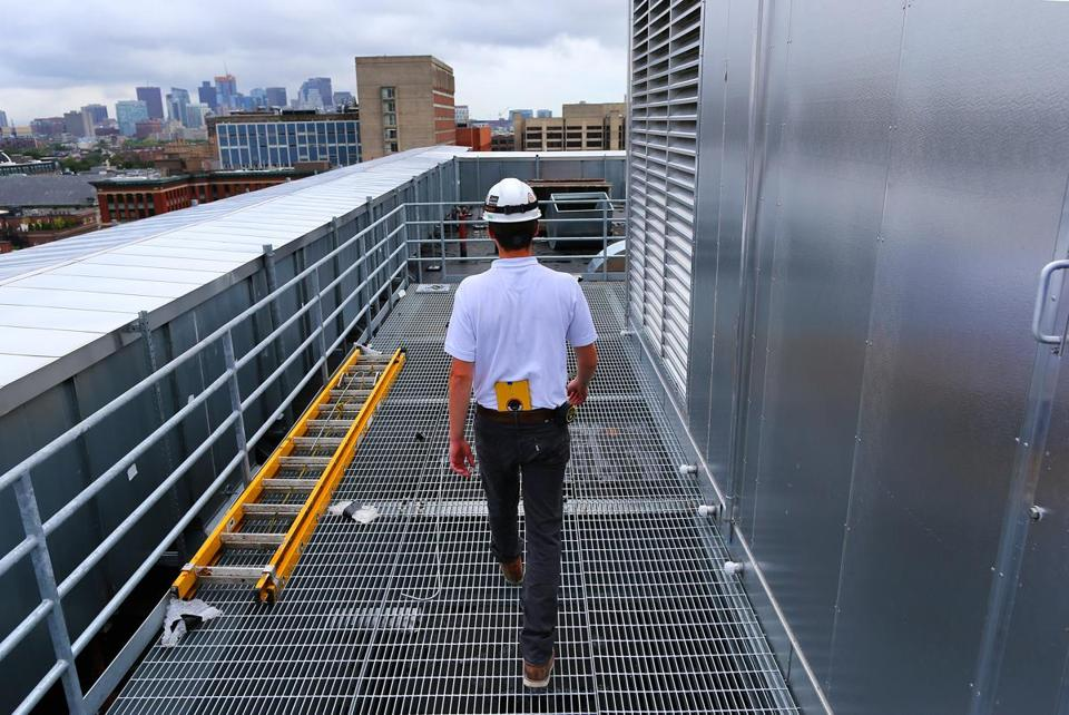Eric Zeimetz of Shawmut Design and Construction walked next to the new air handling system on the roof of the Yawkey Building.