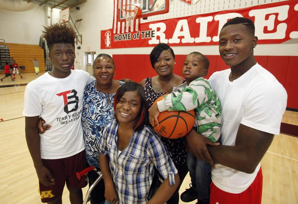 Terry Rozier (right) with family members at the Terry Rozier Basketball Camp at Shaker Heights High School in Shaker Heights, Ohio. From left: Rozier's brother B.J. Carter, grandmoth Amanda Tucker, sister TreDasia Tucker,  mother Gina Tucker, and son Justin.