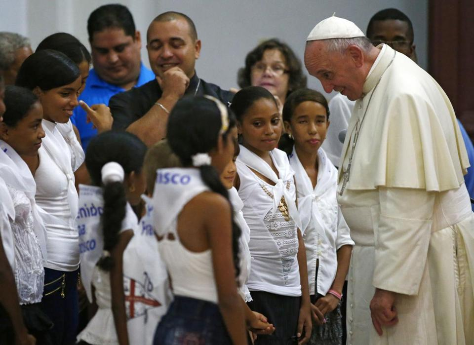 Pope Francis greeted children at the basilica of Our Lady of Charity of El Cobre in Santiago de Cuba on Monday. Santiago was the pope's last stop before heading to the US.