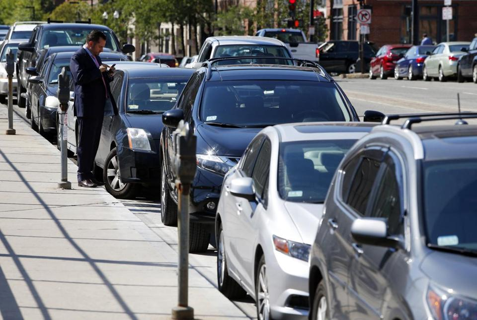 Gary Casagrande of Salem checked his phone after parking on Columbus Avenue in Boston.