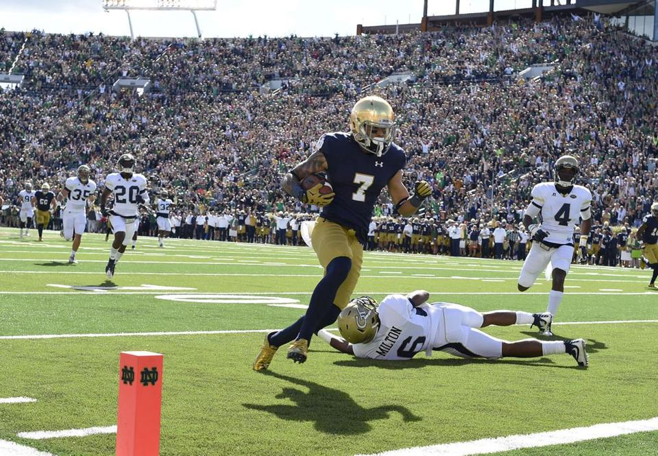 Sep 19, 2015; South Bend, IN, USA; Notre Dame Fighting Irish wide receiver Will Fuller (7) catches a touchdown pass past Georgia Tech Yellow Jackets defensive back Chris Milton (6) and Jamal Golden (4) in the first quarter at Notre Dame Stadium. Mandatory Credit: RVR Photos-USA TODAY Sports