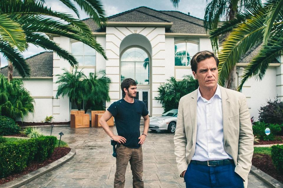 "Michael Shannon (fore-ground) and Andrew Garfield star in ""99 Homes."""