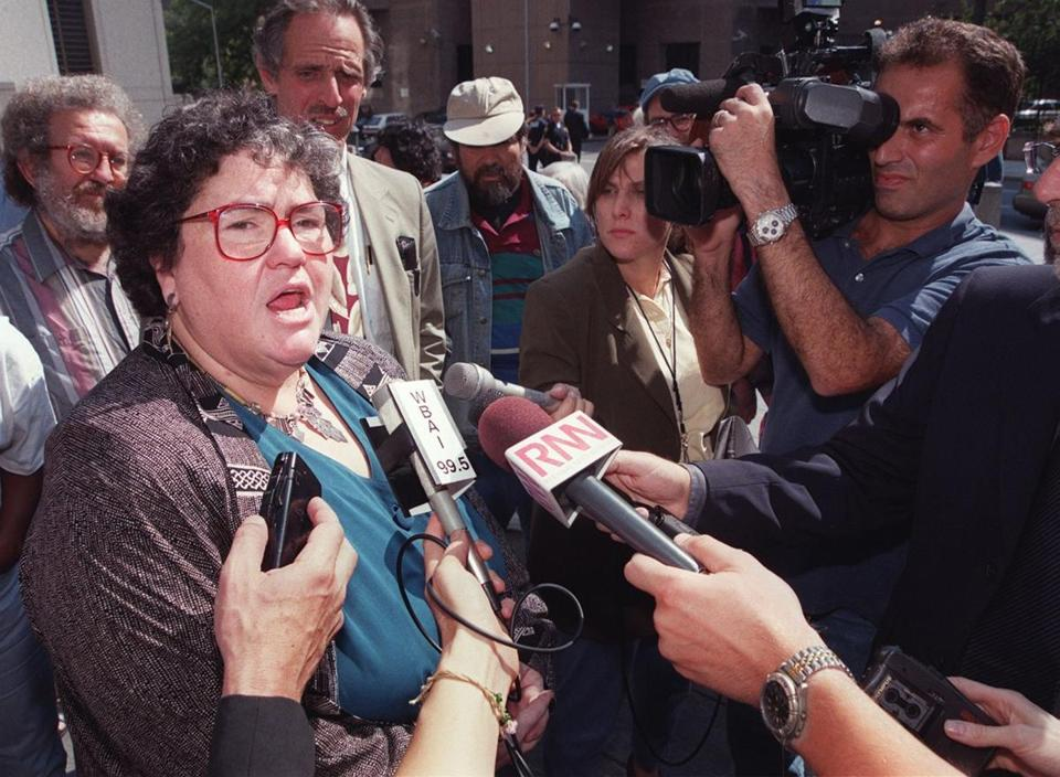 Ms. Fink with reporters in 1999. She defended Black Panthers, inmates, and conspirators.