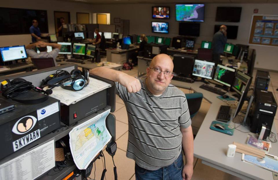 Ham radio operator Rob Macedo inside the National Weather Service Headquarters in Taunton, where he occasionally volunteers.