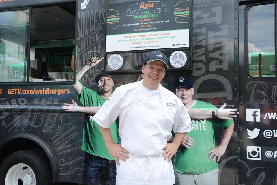 "Paul Wahlberg posed with ""Wahlburgers on Wheels"" last year at Faneuil Hall. The chain's latest location opens Thursday in the Fenway."