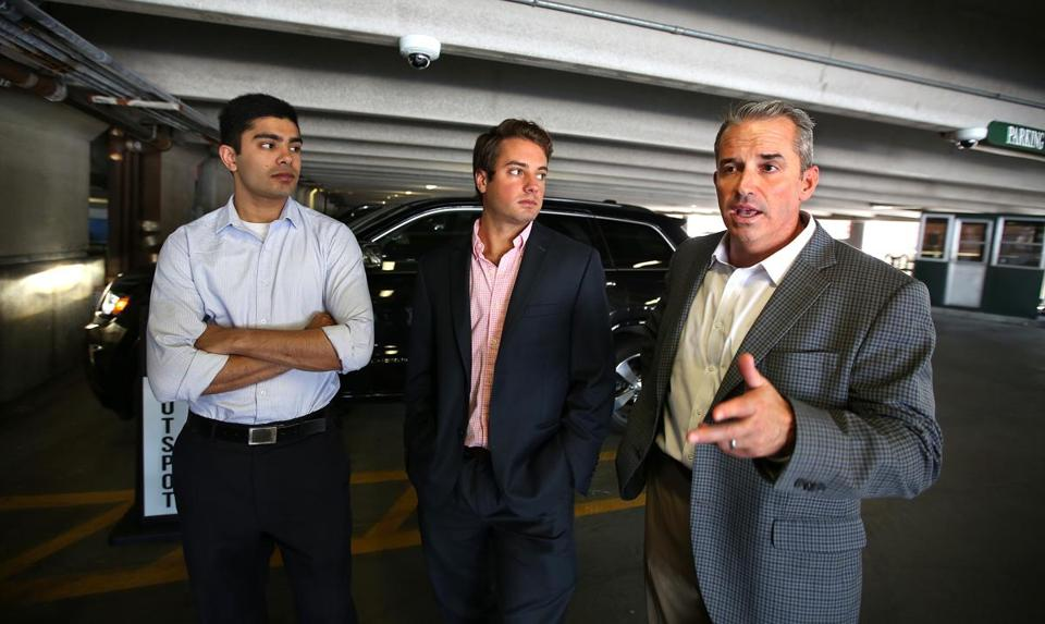 SpotLight Parking CTO Karan Singhal (left) and CEO Mike Miele (center) listen to Kevin J. Leary, president of VPNE.