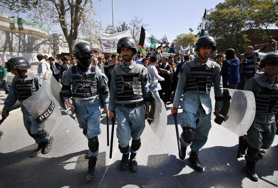 Members of the Afghan security forces walked ahead of an anti-Taliban protest in Kabul on Thursday.