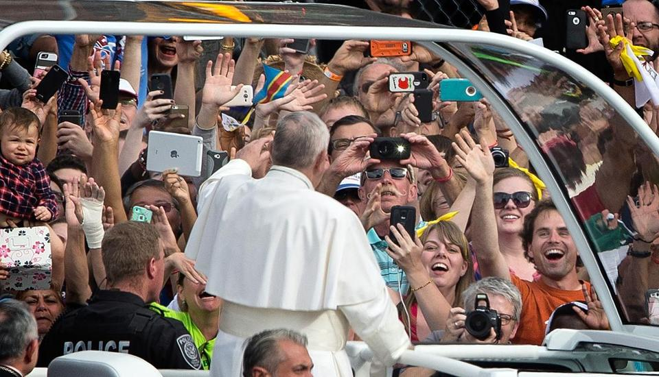 Pope Francis greeted a camera-bearing crowd at Independence Mall, Sept. 26, in Philadelphia.