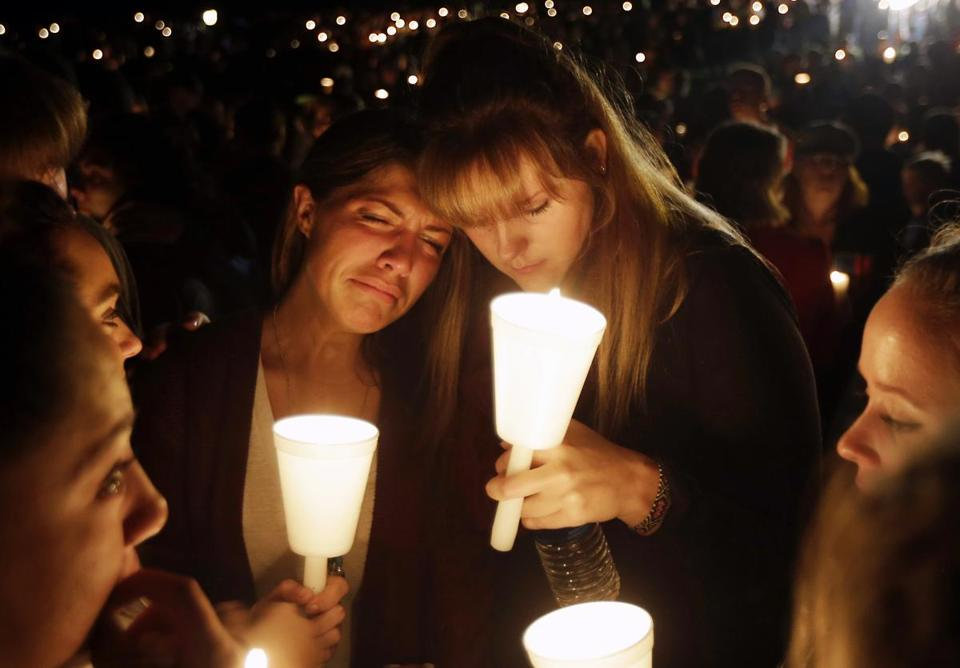 Kristen Sterner (left) and Carrissa Welding, both students of Umpqua Community College, embraced each other during a vigil for the victims of Thursday's shooting.