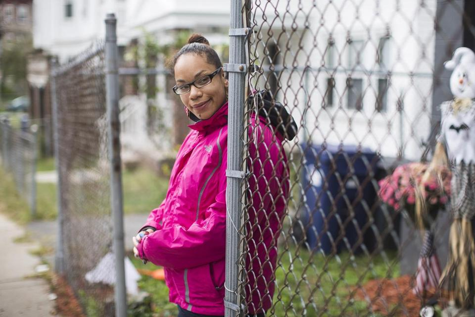 Jacqueline Carrasquillo, a former Long Island resident, stood in front of the halfway house where she lives in Dorchester.