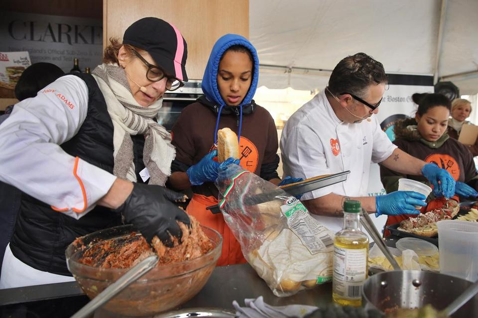 "Chefs Jodi Adams and Andy Husbands (cq) along with sous chefs Francisca Barros Depina and Joahnaliz Baez  from Madison Park High School faced off in a meatball competition during ""Let's Talk About Food "" festival."