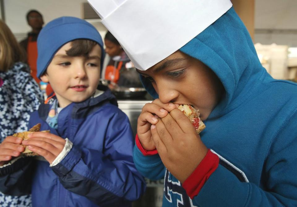 "Evan Hero, left, looked on as Mathious Girmay sampled a turkey meatball in a cook-off during ""Let's Talk About Food"" festival in Copley Square."