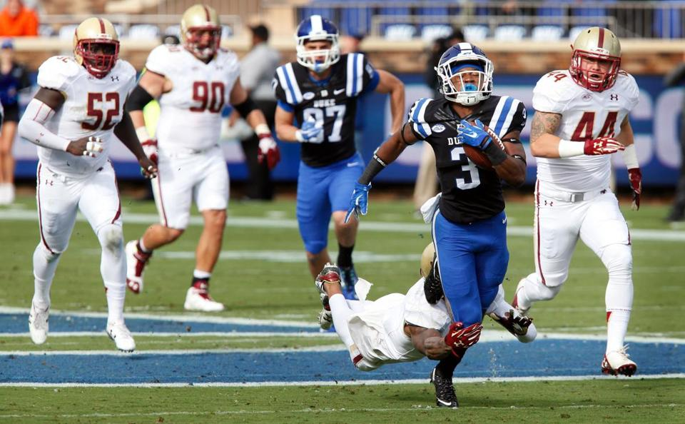 Oct 3, 2015; Durham, NC, USA; Duke Blue Devils wide receiver T.J. Rahming (3) carries the ball as Boston College Eagles defensive back John Johnson (9) defends at Wallace Wade Stadium. Mandatory Credit: Mark Dolejs-USA TODAY Sports
