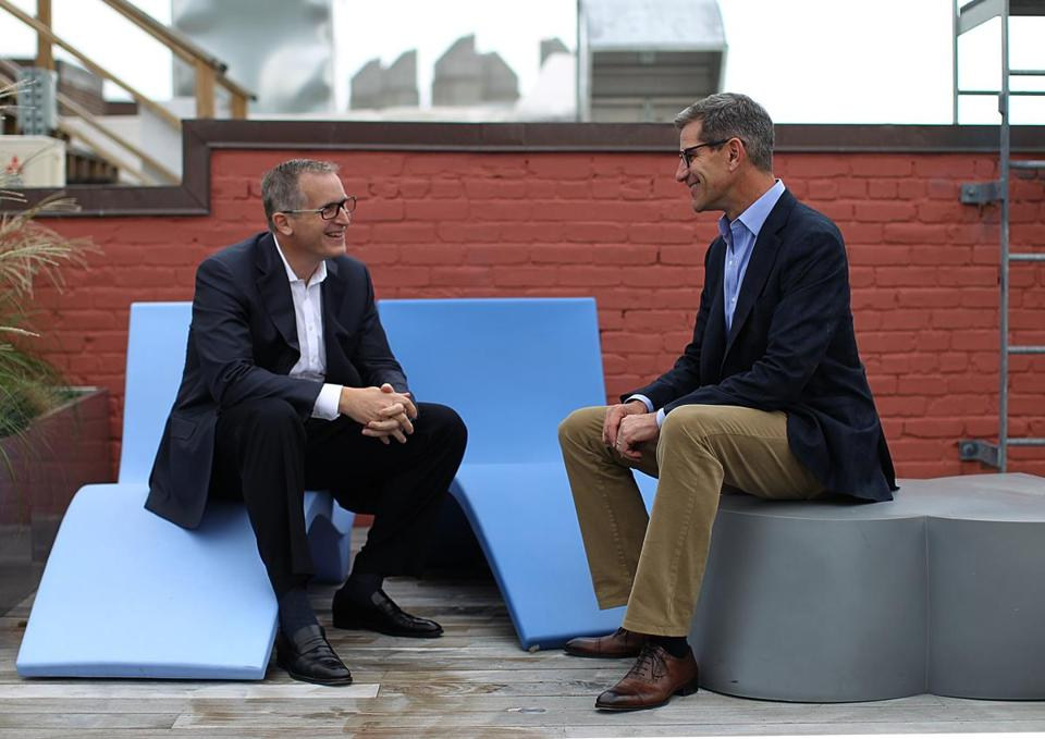 Bill Wagner (left) and Michael Simon of LogMeIn in a 2015 photo. LogMeIn's latest merger with Citrix is expected to result in as much as $100 million in annual expense savings within two years.