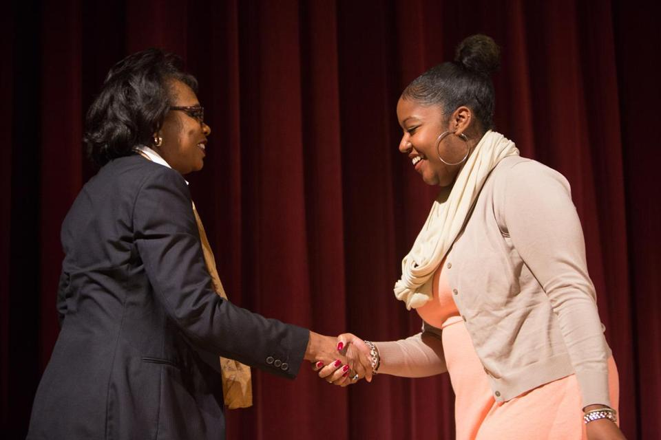 Anita Hill (left) with Lindsay Walcott at Lesley University on Monday.