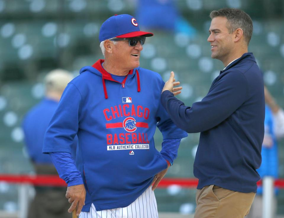 Cubs president Theo Epstein (right) accelerated the team's rebuilding process by bringing in manager Joe Maddon before last season. Now the expectations in Chicago are sky high.