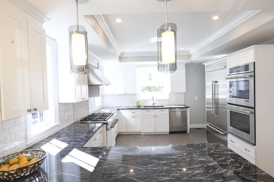 The Kitchen Counters Are Topped With Grigio Carnico Marble From Italy.