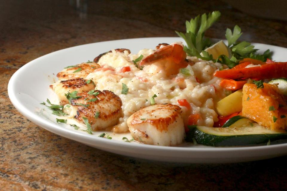Brookline, MA: 10-07-15: Pan seared scallops with shrimp risotto & seasonal vegetables at the Marina Restaurant and Bar at the Wharf in Revere, Mass. October 7, 2015. Photo/John Blanding, Boston Globe staff story/Naomi Kooker, NOWK ( 18nodine )