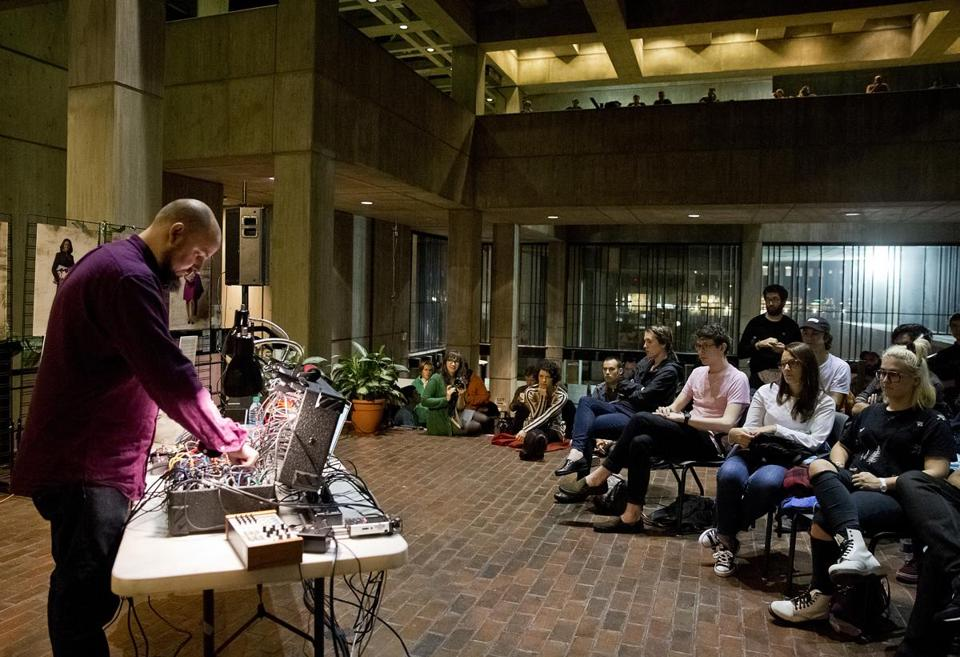 Keith Fullerton Whitman on synthesizer during his concert last Friday at Boston City Hall.