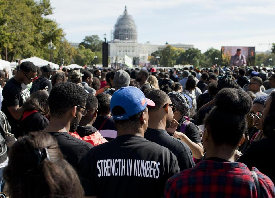 People gathered on the National Mall to listen to speeches at the Justice or Else rally Saturday. Speakers included Louis Farrakhan, the leader of the Nation of Islam.