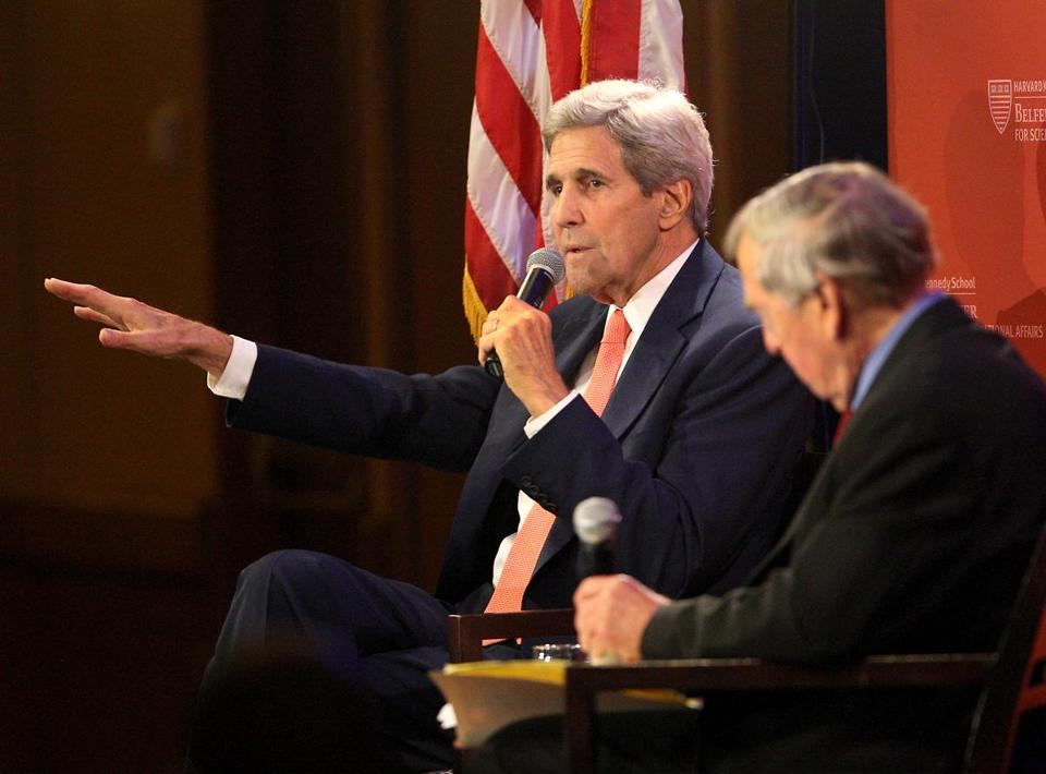 Secretary of State John Kerry took questions Tuesday in Cambridge from Harvard professor Graham Allison (right) among others.