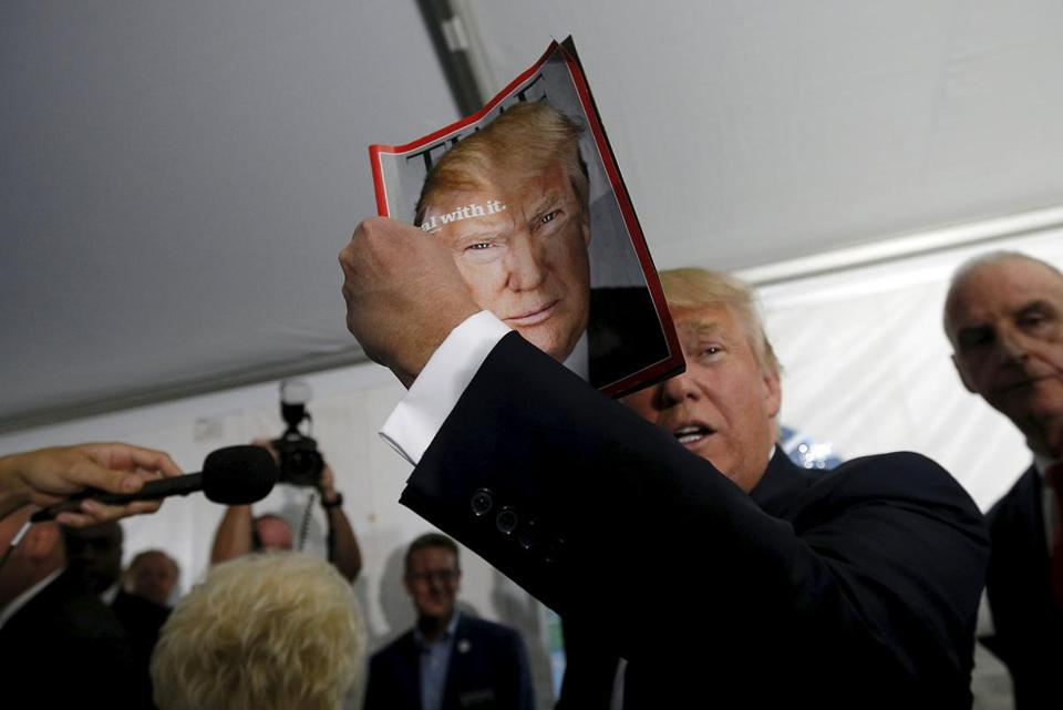 Donald Trump held up the cover of Time magazine with his portrait at a campaign fundraiser at the home of car dealer Ernie Boch Jr. in Norwood.