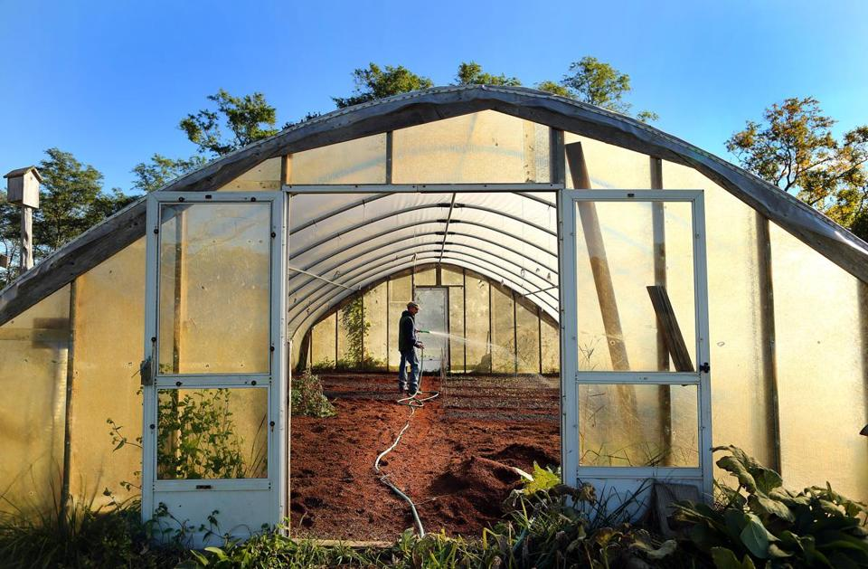 Farmer Jeff Deck grows vegetables year round at his Not Enough Acres Farm thanks to two double-layered plastic greenhouses that keep the temperatures above freezing inside through the winter.