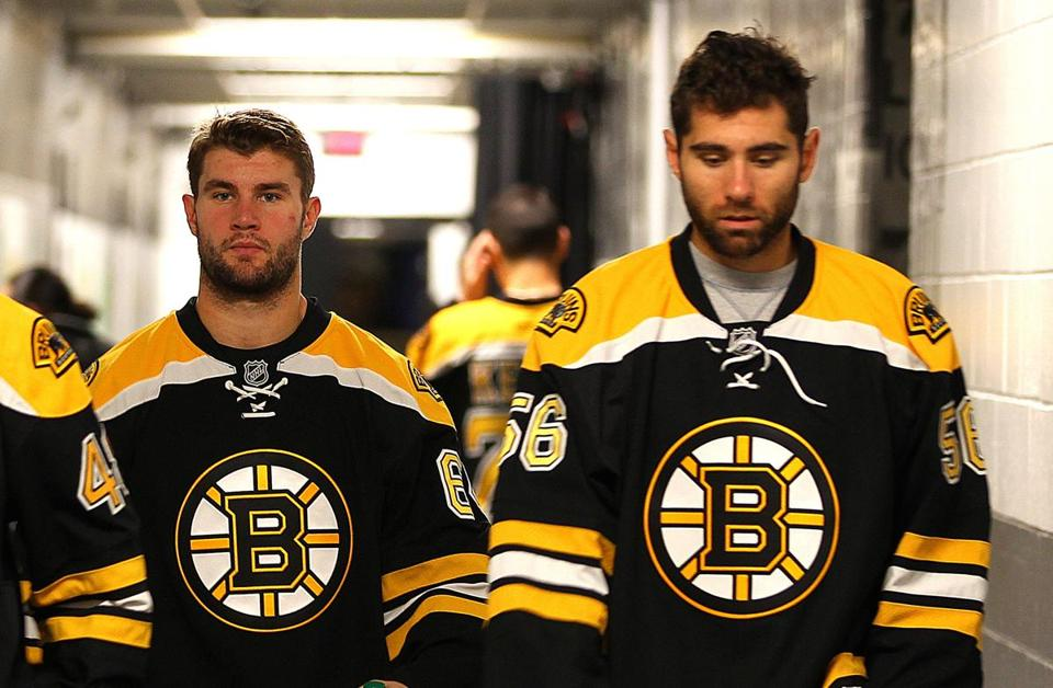 Tyler Randell (left) and Tommy Cross made their NHL debuts Wednesday night with the Bruins in Denver.