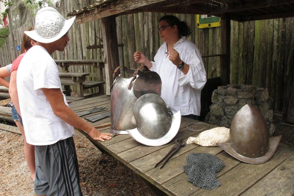 An interpreter at the De Soto National Memorial shows visitors replicas of 16th-century Spanish armor.