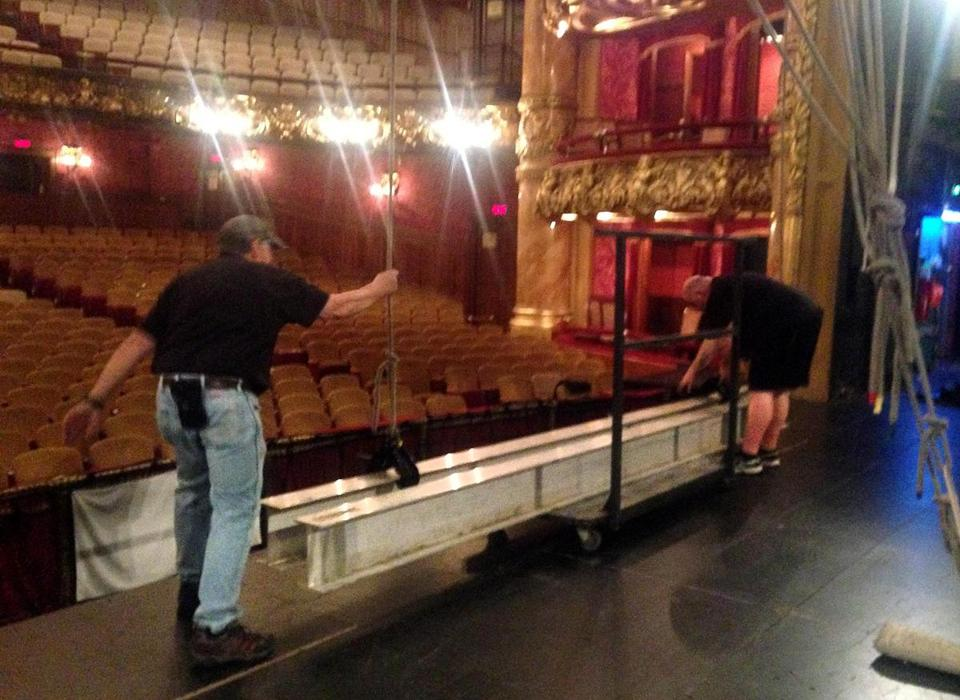 Stagehands dismantled equipment after the last scheduled show, on Oct. 11, at the Colonial Theatre. Emerson College is closing the theater for about a year as it evaluates other possible uses for it.