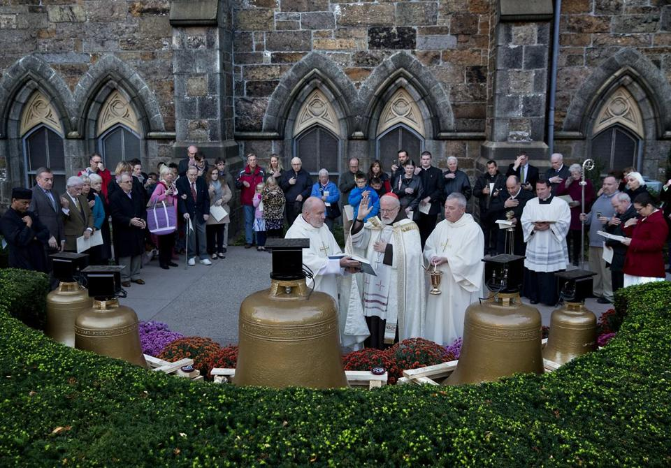 Cardinal Sean O'Malley (center) blessed the bells of the former Holy Trinity German Catholic Church outside the Cathedral of the Holy Cross, where they will be hung soon.