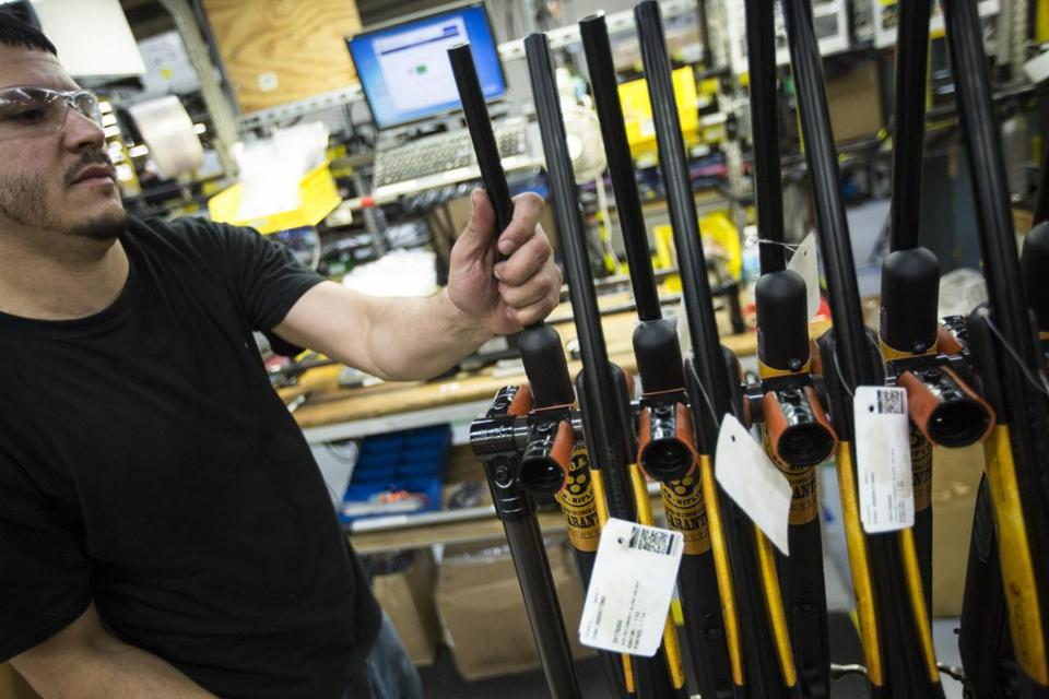 Rifles were stacked before packaging at Smith and Wesson's Springfield factory. Its stock has more than doubled this year.
