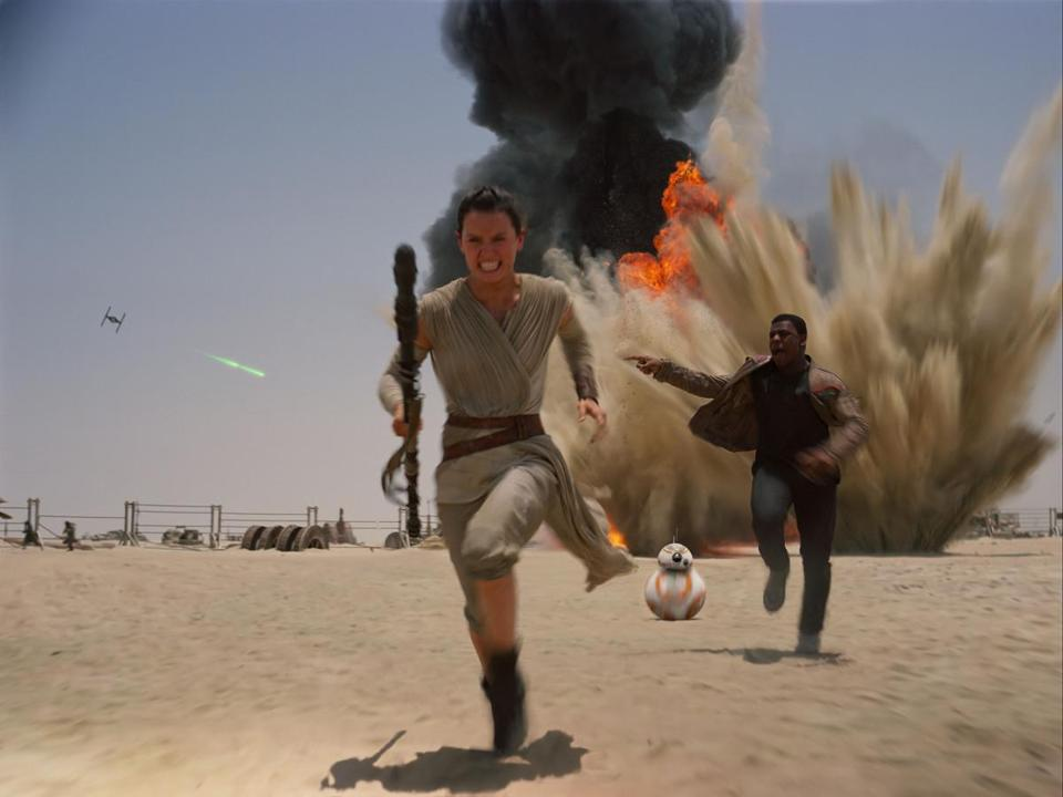 "Daisey Ridley as Rey, left, and John Boyega as Finn, in a scene from the new film, ""Star Wars: The Force Awakens."""
