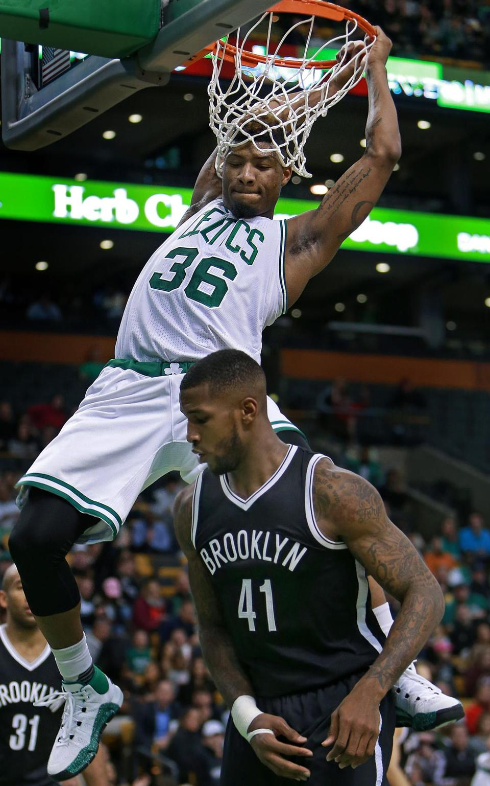 Marcus Smart Took Some Extra Time To Hang On The Net After A Dunk While Brooklyns