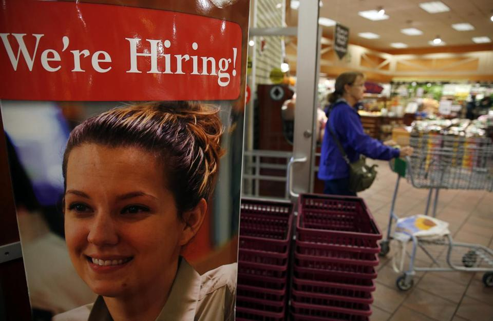 "A sign reading, ""We're Hiring!"" was seen inside of the Roche Bros. store in Acton in October."