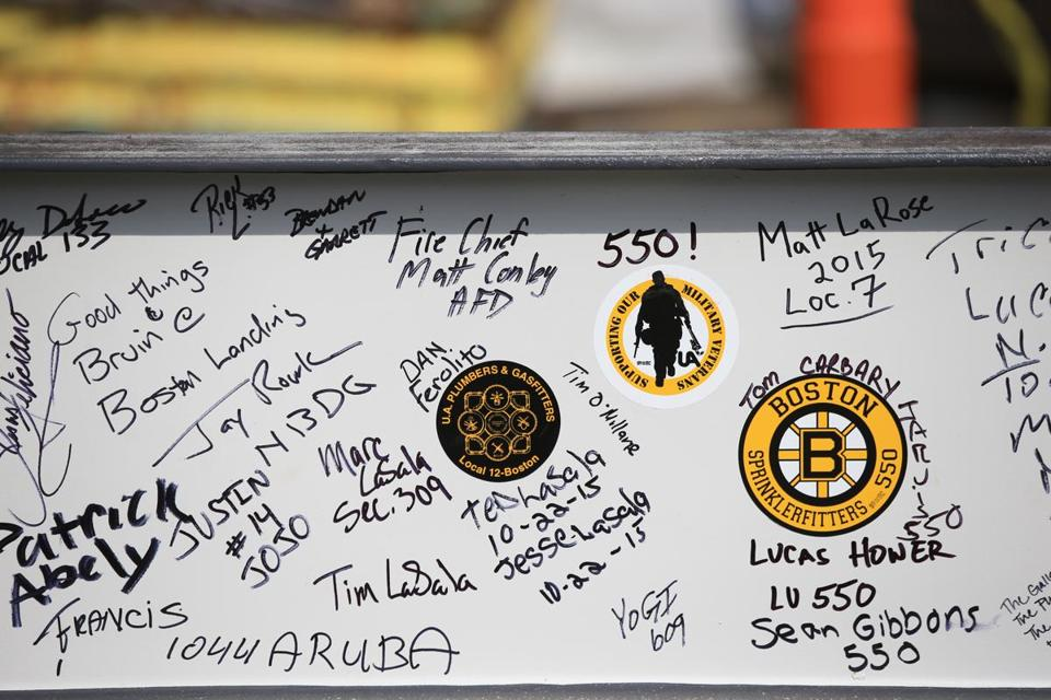 Boston Ma 10/22/2015 Signitures on one of the steel beams as it wait sto be lifted durin Topping off ceremony at the new Warrior Ice Arena at Boston Landing. .Staff/Photographer Jonathan Wiggs Topic: Reporter