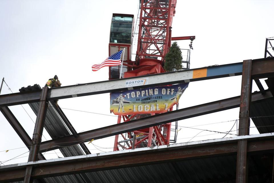 Boston Ma 10/22/2015 One of two steel beams placed at Topping off ceremony at the new Warrior Ice Arena at Boston Landing .Staff/Photographer Jonathan Wiggs Topic: Reporter